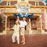 two men posing in front of Disneyland City Hall