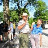 Older park ranger high-fives student