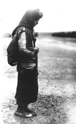Armenia woman refugee, standing alone