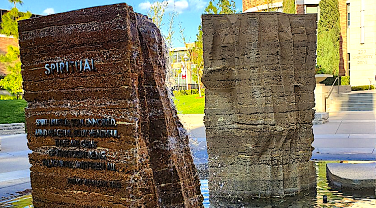 image of stone pillar with the words spiritual on it