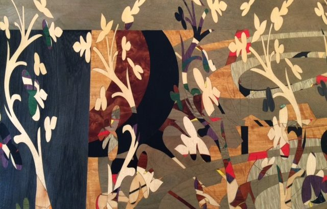 image of marquetry artwork displaying vines and flowers