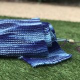 knitted scarf over yarn and knitting needles
