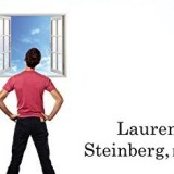 Laurence Steinberg posing in front of a window
