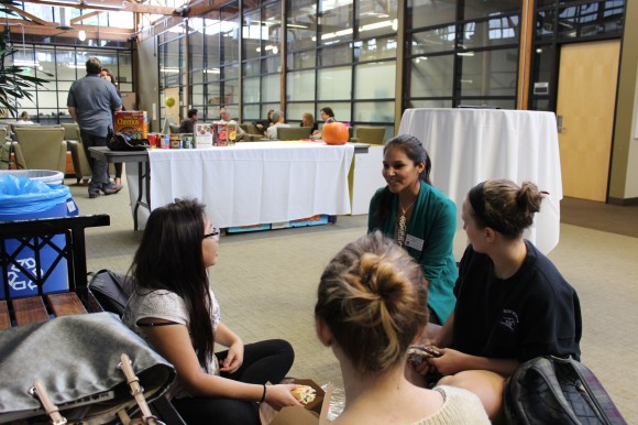 Students in front of a table with lots of donated foods.