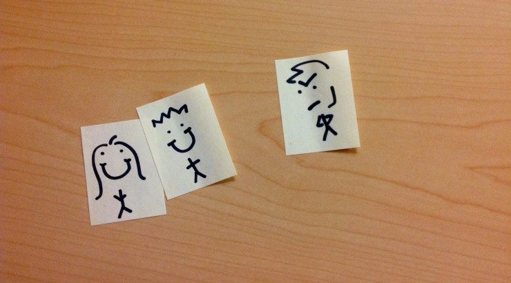 Sticky notes with people drawn on them