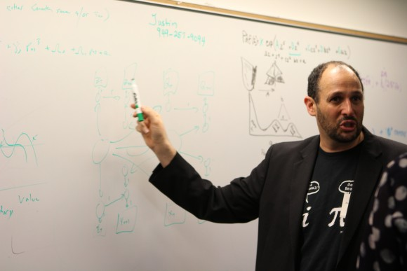 Man with a marker at Chapman Big Data event