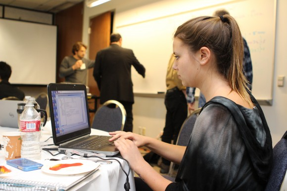 Student on her computer at the Big Data event at Chapman