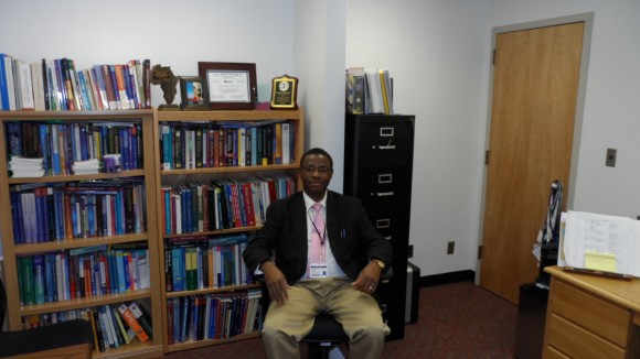 Dr. Emmanuel John in his office.