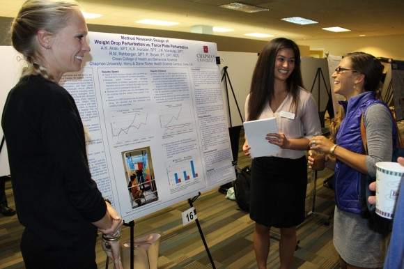 Students presenting information at the Rinker Grad Student Research Day