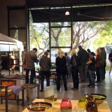 group of people looking at ceramics
