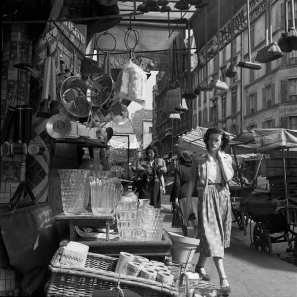 woman walking through a street shop