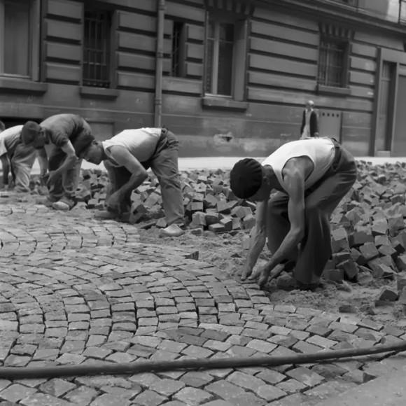 men moving bricks
