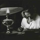 black and white photo of man writing
