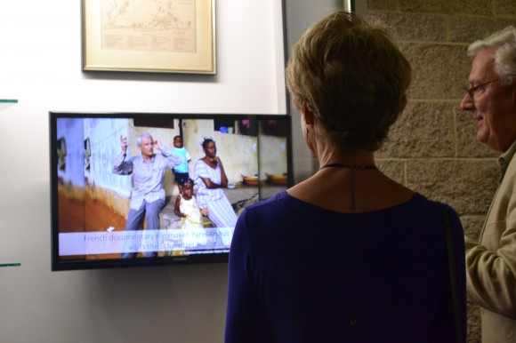 two people looking at a tv screen