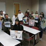 students holding artwork