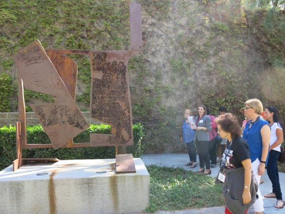 people looking at a sculpture
