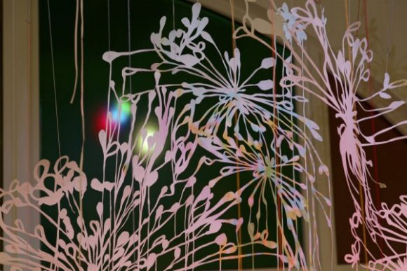 Chris Natrop, Between Light and Half Light, watercolor, glitter, aluminum powder on hand cut paper, tape, string, color window clings, 2016