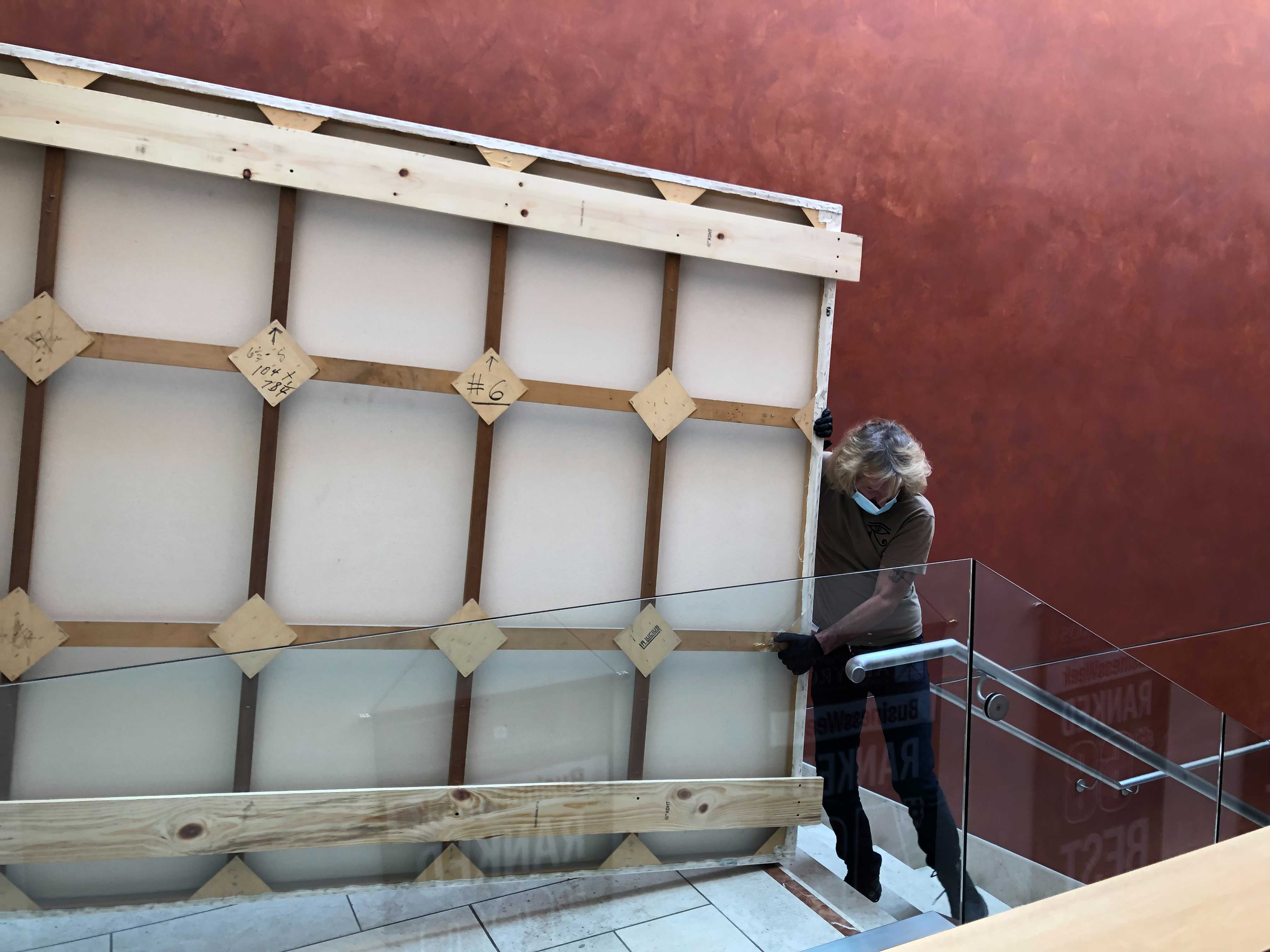 Back of painting being carried downstairs.