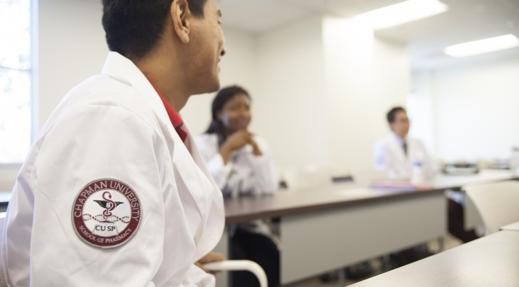 Chapman University School of Pharmacy students attentively learn in the classroom.