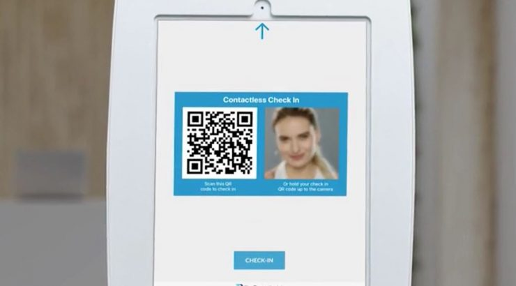 Picture of an iPad with split screen displaying a QR code on the left and photo of the visitor on the right.