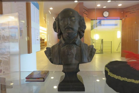 Shakespeare bust in display case.