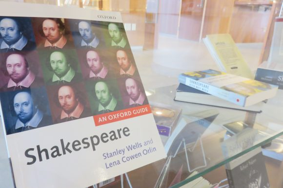 Shakespeare book on display case.