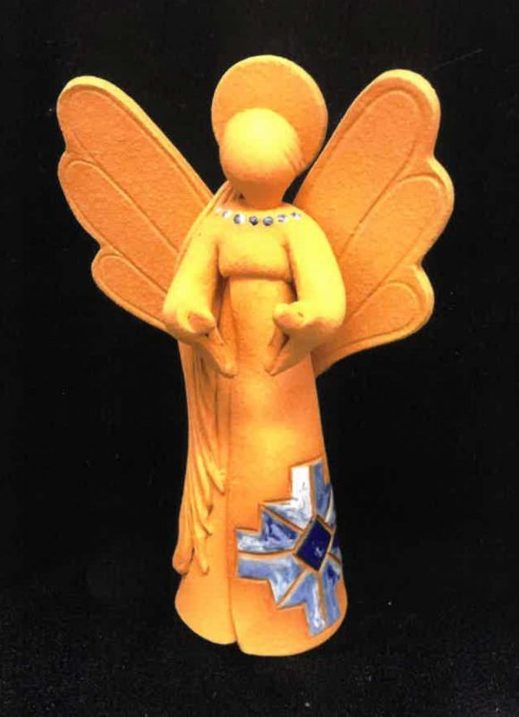 A small ceramic figurine of an angel, in Native American-styled garb.