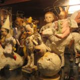 A collection of papier-mache angel figurines on a shelf.