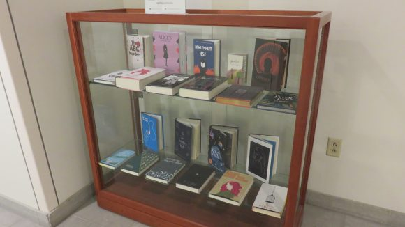 Books displayed in a glass case.