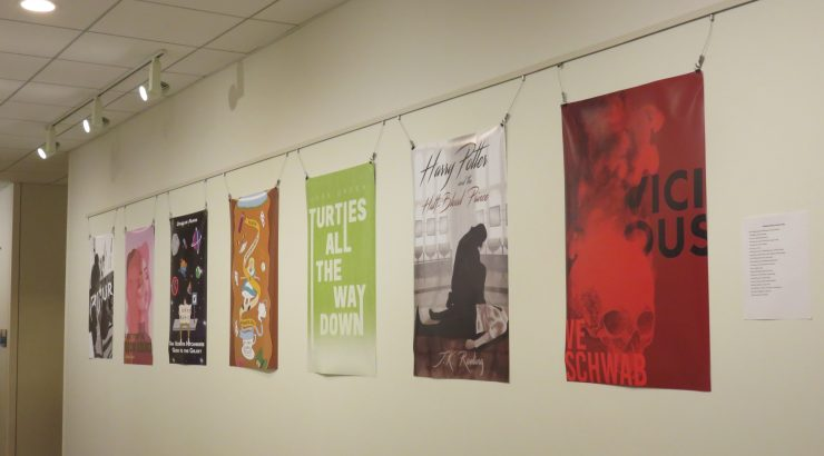 Posters hanging on a wall.