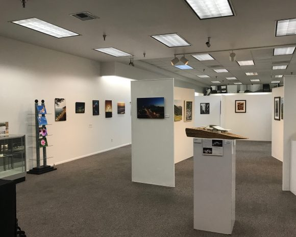 Photograph of several pieces of art displayed in an exhibit