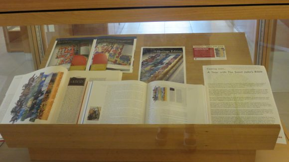 Open books, pamphlets, and flyers inside a display case