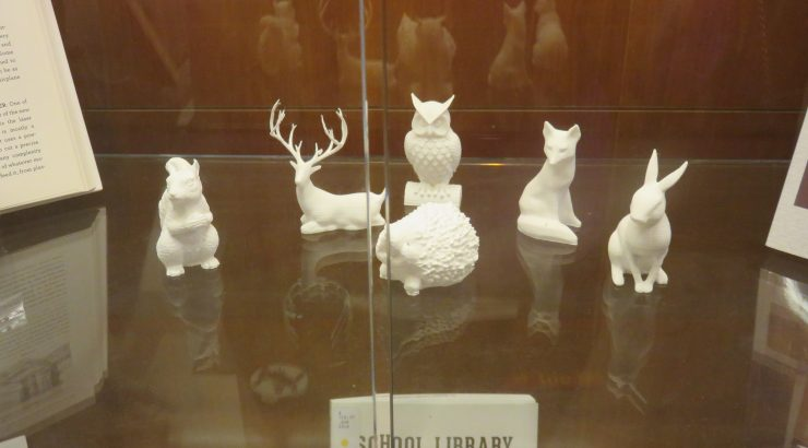 Six small white 3D-printed figurines of animals - a squirrel, a deer, a hedgehog, an owl, a fox, and a rabbit