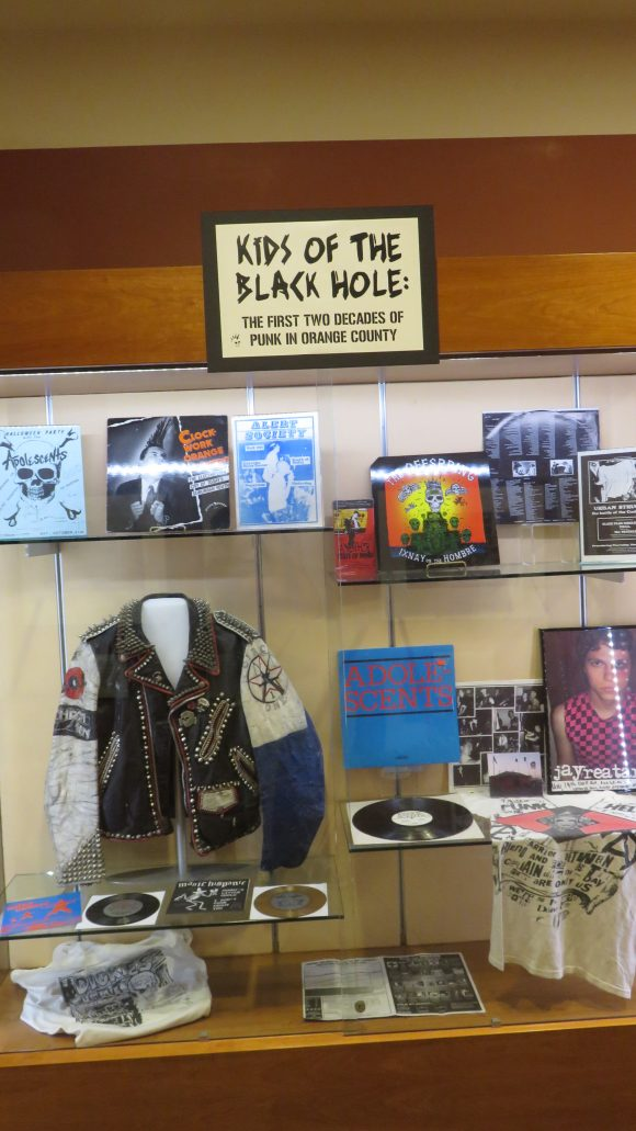 A cabinet filled with punk rock memorabilia