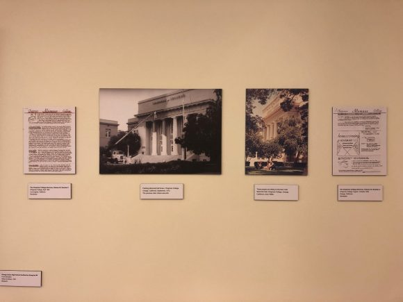 Photos of a display, which consists of architectural blueprints, reproductions of old architectural photographs, and explanatory text reproduced in this blog post.