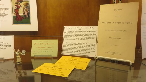 A collection of paper documents on display