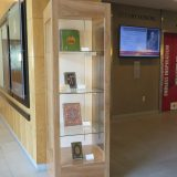 A display case standing in a lobby
