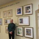 President Doti stands in front of the new Children's Books By James L. Doti wall