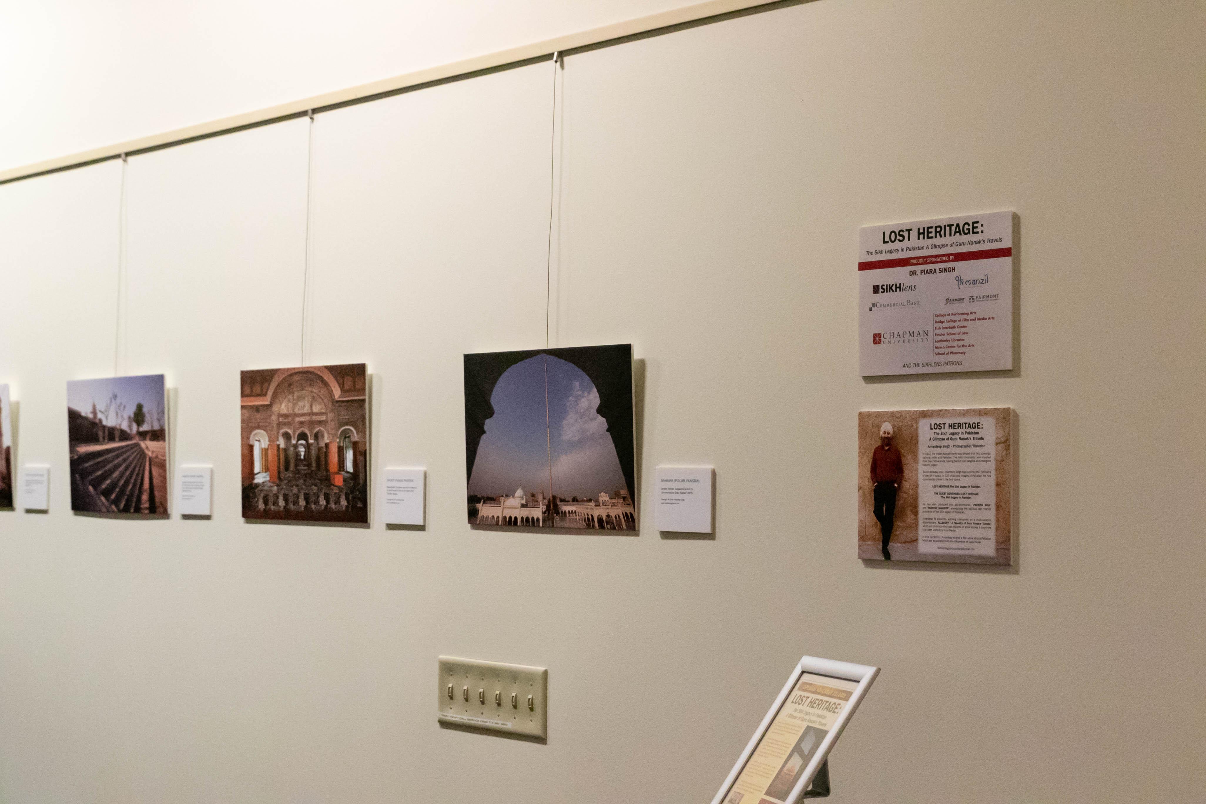 Four framed photos on a wall