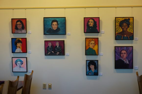 Framed portraits hanging on a wall
