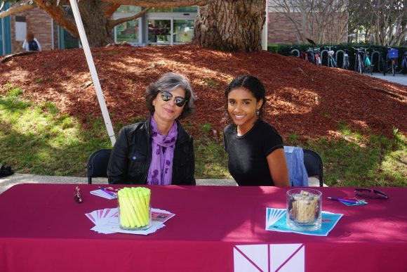 Librarian Shahrzad Khosrowpour with student employee Ruby Blakesleay.