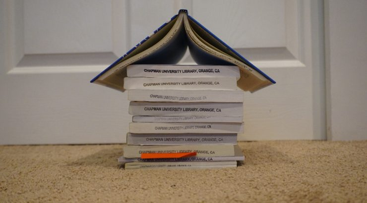 A stack of books, all facing to show their