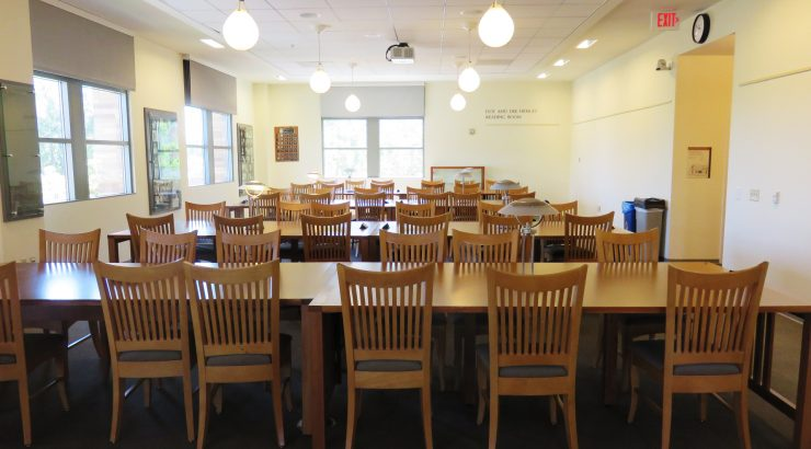 Image of the tables and chairs in the Doy and Dee Henley Reading Room, with no people.