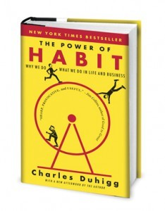 Cover of the book The Power of Habit. The cover is yellow with red and black font, and there is a simple image of three black stick figures on a red spinning wheel