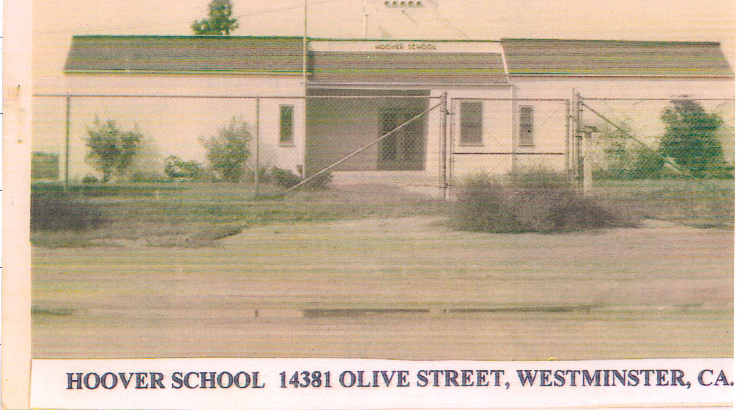 Newspaper photograph of the Hoover School with text across the bottom that reads,