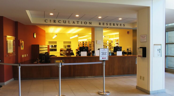 Photograph of the Circulation Desk in the Leatherby Libraries