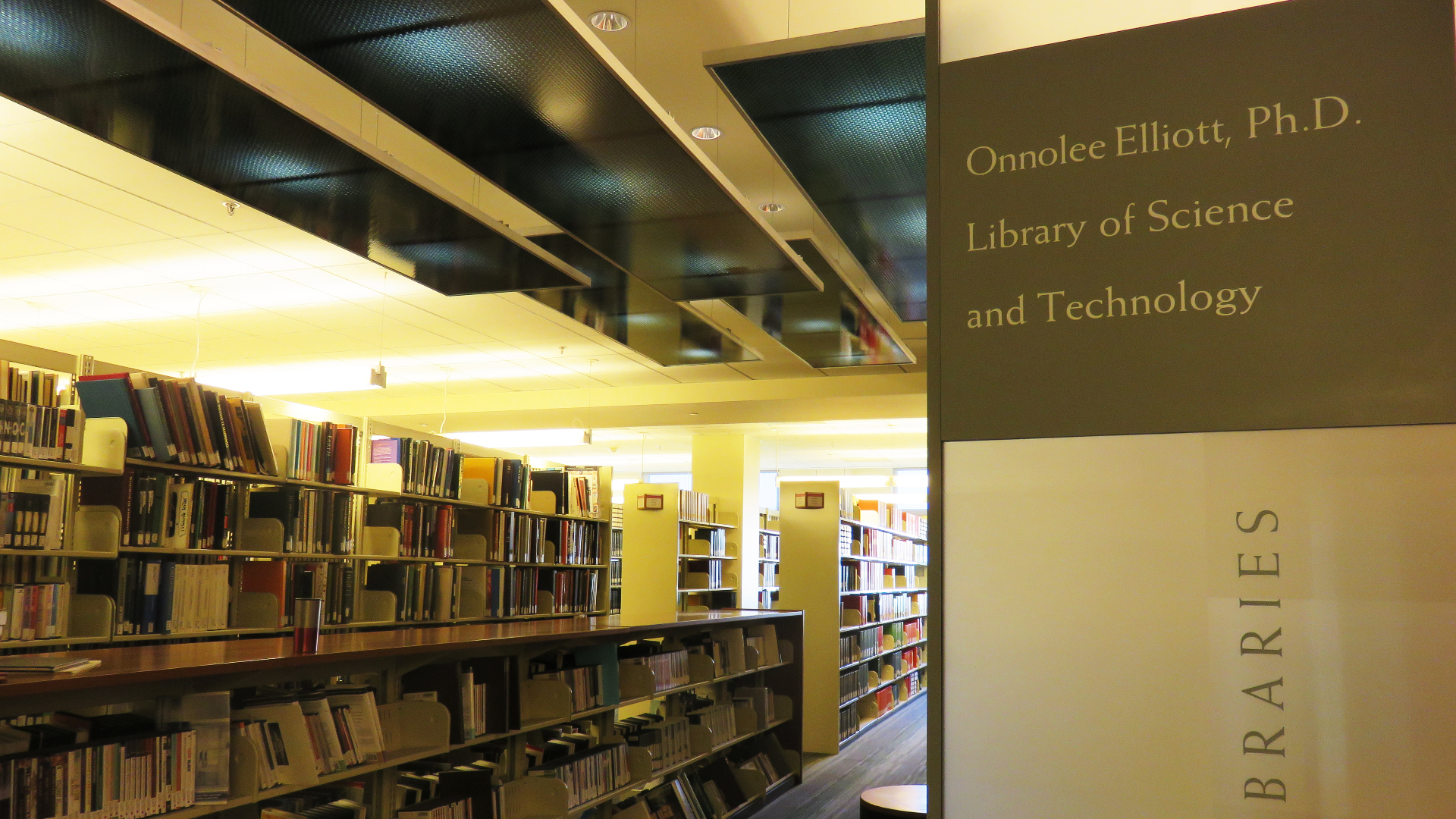 Bookshelves and the sign for the Onnolee Elliott Ph.D. Library of Science and Technology
