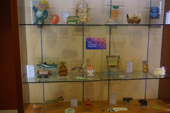 A large display case with die-cut papers.