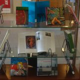 A display case containing books.