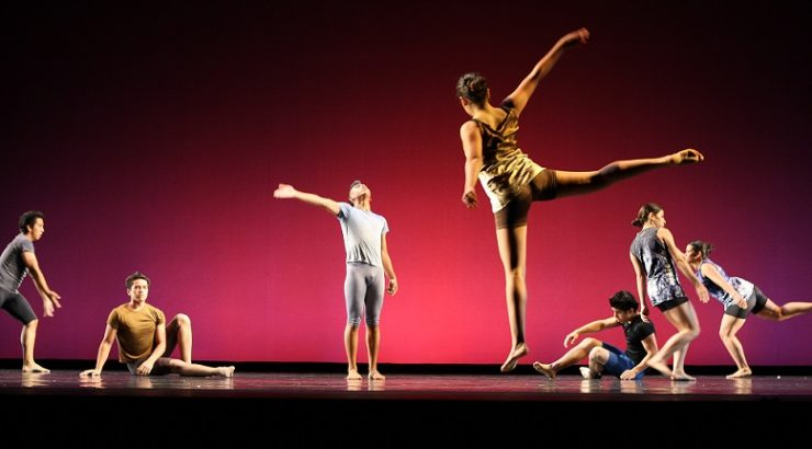 Students perform a dance performance on stage.